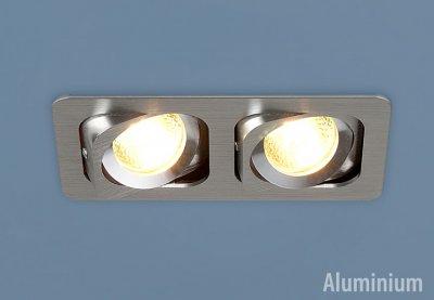 1021/2 CH (хром) Электростандарт Алюминиевый точечный светильникКарданные светильники<br>Лампы: 2 x MR16 G5.3 max 50 Вт Размер: 173 х 93 мм Высота внутренней части: ? 25 мм Высота внешней части: ? 3 мм Монтажное отверстие: 150 х 80 мм Гарантия: 2 года Светильники имеют поворотный механизм Корпус из алюминия<br><br>Тип лампы: галогенная<br>Тип цоколя: G5.3<br>Количество ламп: 2<br>Ширина, мм: 92<br>Диаметр врезного отверстия, мм: 92 x 172<br>Длина, мм: 172<br>Высота, мм: 35<br>MAX мощность ламп, Вт: 50