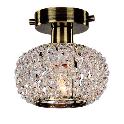 Светильник бра Favourite 1391-1UХрустальные<br><br><br>S освещ. до, м2: 2<br>Крепление: планка<br>Тип лампы: накаливания / энергосбережения / LED-светодиодная<br>Тип цоколя: E14<br>Количество ламп: 1<br>MAX мощность ламп, Вт: 40<br>Диаметр, мм мм: 140<br>Размеры: D140*H120<br>Высота, мм: 120<br>Цвет арматуры: бронзовый