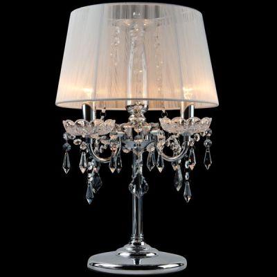 Светильник настольный Евросвет 2045/3T хром/белыйХрустальные<br>Настольная лампа – это не просто источник дополнительного освещения, но и оригинальный элемент декора. Его можно установить в спальне, гостиной, кабинете и других комнатах. Интернет-магазин «Светодом» предлагает настольные лампы разных стилей по доступным ценам. Благодаря большому ассортименту Вы обязательно найдете в нашем каталоге именно ту модель, которую искали.   Настольная лампа Евросвет 2045/3T – прекрасный вариант для завершения интерьера. Ее можно включить одновременно с люстрой для более яркого освещения или без нее для создания уютной атмосферы, настраивающей на отдых.   Купить настольную лампу Евросвет 2045/3T Вы можете с помощью виртуальной «Корзины» или по контактным номерам, указанным на сайте.<br><br>S освещ. до, м2: 12<br>Тип лампы: накал-я - энергосбер-я<br>Тип цоколя: E14<br>Количество ламп: 3<br>MAX мощность ламп, Вт: 60<br>Диаметр, мм мм: 300<br>Высота, мм: 480<br>Цвет арматуры: серебристый