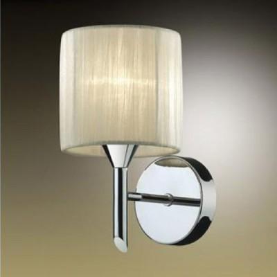 Светильник Odeon Light 2085/1W Niola хромСовременные<br>Настенное бра – приятная необходимость, когда речь идёт о дополнительном источнике освещения. Очень уместен в рамках огромного разнообразия светильников лаконичный силуэт и гармоничные формы классического исполнения. Речь идёт об изящном настенном бра Odeon Light 2085/1W. Его основная конструкция выполнена из хрома, отличающего голубовато-стальным сиянием. Тканевый абажур светильника мягко рассеивает яркость лучей по каждым точкам выбранного участка. Для чтения, бесед, размышлений, просто наблюдений создано бра Odeon Light 2085/1W. К тому же это прекрасный элемент декора, выполненный в классическом стиле. Сделайте выбор в пользу безупречности освещения Вашего интерьера!<br><br>S освещ. до, м2: 2<br>Тип лампы: накал-я - энергосбер-я<br>Тип цоколя: E14<br>Количество ламп: 1<br>Ширина, мм: 140<br>MAX мощность ламп, Вт: 40<br>Расстояние от стены, мм: 180<br>Высота, мм: 230<br>Цвет арматуры: серебристый
