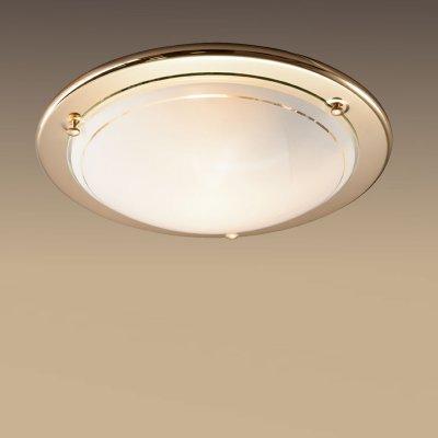 Светильник Сонекс 115 золото RigaКруглые<br>Настенно потолочный светильник Сонекс (Sonex) 115 подходит как для установки в вертикальном положении - на стены, так и для установки в горизонтальном - на потолок. Для установки настенно потолочных светильников на натяжной потолок необходимо использовать светодиодные лампы LED, которые экономнее ламп Ильича (накаливания) в 10 раз, выделяют мало тепла и не дадут расплавиться Вашему потолку.<br><br>S освещ. до, м2: 6<br>Тип лампы: накаливания / энергосбережения / LED-светодиодная<br>Тип цоколя: E27<br>Количество ламп: 1<br>MAX мощность ламп, Вт: 100<br>Диаметр, мм мм: 310<br>Цвет арматуры: золотой