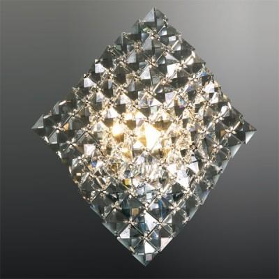 Светильник Odeon Light 2181/1W хром FittaХрустальные<br>Настенный светильник Odeon Light 2181/1W хром Fitta притягивает к себе внимание и завораживает благодаря своей необычной форме. Он кардинально отличается от привычных представлений о таких источниках света, напоминая, скорее, прозрачную кружевную ткань, чем осветительный прибор! Луч, попадая на множество хрустальных граней, отражается и преломляется в них под разными углами, создавая неповторимое, «искрящееся» освещение, которое наполнит Ваш дом уютом, очарованием и красотой. Светильник можно использовать в любой по функциональному назначению комнате и с различными цветовыми оттенками – от однотонных до многоцветных. Дополнит и объединит общую «линию» стиля потолочная люстра из этой же серии.<br><br>S освещ. до, м2: 2<br>Крепление: планка<br>Тип лампы: галогенная / LED-светодиодная<br>Тип цоколя: G9<br>Цвет арматуры: серебристый<br>Количество ламп: 1<br>Ширина, мм: 250<br>Высота, мм: 490<br>MAX мощность ламп, Вт: 40