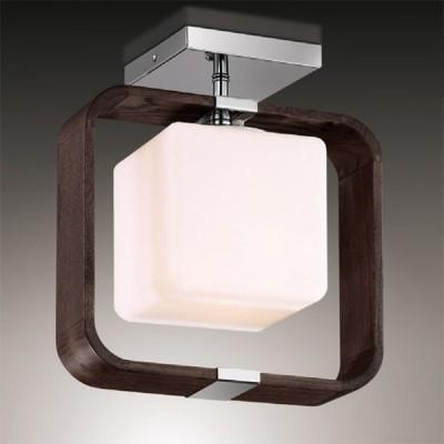 Светильник Odeon Light 2199/1C хром ViaПотолочные<br>Эстетика в кубах – это свежесть, оригинальность и истинный модерн в освещении! Потолочная люстра Odeon Light 2199/1C, с одной стороны, демонстративна в своём изысканном вкусе, с другой, реализует в себе гармоничные пропорции практичности и эстетики. Лёгкая геометрия и ощущение невесомости характеризуют образ светильника в стиле модерн. Конструкция люстры Odeon Light 2199/1C представляет собой совмещение двух стилизованных кубов, где один является огранкой другого. Также интересно сочетание хромированных деталей, элементов из тёмного дерева и ламп со смягчёнными краями. Это стильно и оригинально! Вам просто гарантирован яркий свет и уникальный дизайн от люстры  Odeon Light 2199/1C!<br><br>Установка на натяжной потолок: Ограничено<br>S освещ. до, м2: 4<br>Крепление: планка<br>Тип лампы: накаливания / энергосбережения / LED-светодиодная<br>Тип цоколя: E27<br>Количество ламп: 1<br>MAX мощность ламп, Вт: 60<br>Диаметр, мм мм: 290<br>Высота, мм: 245<br>Цвет арматуры: серебристый