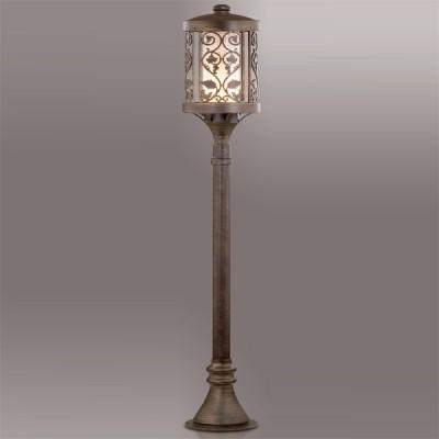 Светильник Odeon light 2286/1A патина коричневый KordiОдиночные столбы<br>Освещение экстерьера должно быть не просто высококачественным и практичным, но и эстетически стилизованным. В этом вопросе на славу потрудились итальянские производители, создавшие изящный фонарный столб Odeon light 2286/1A. С одной стороны, он выполнен в брутальной манере прочного и стойкого изделия, с другой, флористический узор конструкции смягчает мощный силуэт. Цвет коричневой патины особенно актуален для экстерьерных экспозиций, как универсальный. Уличный светильник Odeon light 2286/1A представлен в лаконичном размере 150 см. Вы сможете использовать не одно изделие, а целый тандем для стилизованного наполнения придомовой площадки. Безупречная экстерьерная эстетика светом!<br><br>S освещ. до, м2: до 6<br>Тип лампы: накаливания / энергосбережения / LED-светодиодная<br>Тип цоколя: E27<br>Количество ламп: 1<br>MAX мощность ламп, Вт: 100<br>Диаметр, мм мм: 211<br>Высота, мм: 1200<br>Цвет арматуры: коричневый