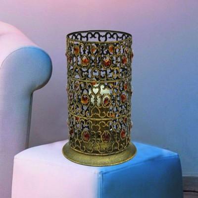 Светильник настольный Favourite 2312-1T MaroccoВосточный стиль<br>Настольная лампа – это не просто источник дополнительного освещения, но и оригинальный элемент декора. Его можно установить в спальне, гостиной, кабинете и других комнатах. Интернет-магазин «Светодом» предлагает настольные лампы разных стилей по доступным ценам. Благодаря большому ассортименту Вы обязательно найдете в нашем каталоге именно ту модель, которую искали.   Настольная лампа Favourite 2312-1T – прекрасный вариант для завершения интерьера. Ее можно включить одновременно с люстрой для более яркого освещения или без нее для создания уютной атмосферы, настраивающей на отдых.   Купить настольную лампу Favourite 2312-1T Вы можете с помощью виртуальной «Корзины» или по контактным номерам, указанным на сайте.<br><br>S освещ. до, м2: 4<br>Тип лампы: накаливания / энергосбережения / LED-светодиодная<br>Тип цоколя: E27<br>Количество ламп: 1<br>MAX мощность ламп, Вт: 60<br>Диаметр, мм мм: 160<br>Размеры: D160*H245<br>Высота, мм: 245<br>Оттенок (цвет): черный<br>Цвет арматуры: золотой с чернением