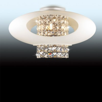 Люстра Odeon light 2604/4CПотолочные<br>Элегантность, роскошь, тщательная обработка каждой детали – основные черты, характеризующие потолочный светильник Odeon light 2604/4С! Оригинальная конструкция прекрасно сочетается с плафоном, выполненным из хрусталя, и заставляет вновь и вновь поднимать к себе восхищенный взгляд. Луч, попадая на множество прозрачных граней, создает уникальное, «искрящееся» освещение на площади до 11 кв.м. Этот светильник станет настоящим украшением любой комнаты, а совместно с настенными бра и настольной лампой из этой же серии, он сделает интерьер «цельным», гармоничным и уютным.<br><br>Установка на натяжной потолок: Ограничено<br>S освещ. до, м2: 11<br>Крепление: Планка<br>Тип цоколя: G9<br>Количество ламп: 4<br>MAX мощность ламп, Вт: 40<br>Диаметр, мм мм: 450<br>Высота, мм: 240<br>Оттенок (цвет): белый<br>Цвет арматуры: серебристый