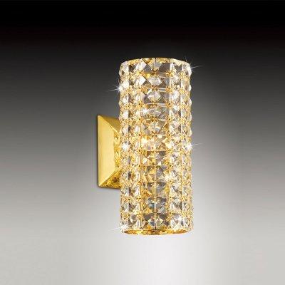 Светильник Odeon light 2608/1WХрустальные<br>Яркий, запоминающийся настенный светильник Odeon light 2608/1W внесет в Ваш интерьер роскошный и «благородный» облик, станет его «изюминкой» и украшением! Плафон, выполненный из множества хрустальных вставок, гармонично сочетается с «золотым» оттенком крепления и арматуры и создает уникальное, «искрящееся» освещение. Наиболее «выигрышно» он будет смотреться в комнате, где в цветовой гамме преобладают «теплые» тона («золотистые», «молочные», «бежевые» и т.п). Рекомендуем Вам использовать бра в комплекте из нескольких экземпляров и люстрой из этой же серии, тогда интерьер будет выглядеть «законченным» и совершенным, как будто над ним поработал профессиональный дизайнер.<br><br>S освещ. до, м2: 3<br>Тип цоколя: G9<br>Количество ламп: 1<br>Ширина, мм: 120<br>MAX мощность ламп, Вт: 40<br>Высота, мм: 260<br>Цвет арматуры: золотой