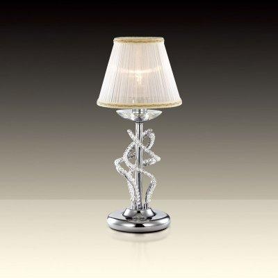 Светильник настольный Odeon light 2611/1TКлассические<br>Настольная лампа – это не просто источник дополнительного освещения, но и оригинальный элемент декора. Его можно установить в спальне, гостиной, кабинете и других комнатах. Интернет-магазин «Светодом» предлагает настольные лампы разных стилей по доступным ценам. Благодаря большому ассортименту Вы обязательно найдете в нашем каталоге именно ту модель, которую искали.   Настольная лампа Odeon light 2611/1T  – прекрасный вариант для завершения интерьера. Ее можно включить одновременно с люстрой для более яркого освещения или без нее для создания уютной атмосферы, настраивающей на отдых.   Купить настольную лампу Odeon light 2611/1T  Вы можете с помощью виртуальной «Корзины» или по контактным номерам, указанным на сайте.<br><br>S освещ. до, м2: 4<br>Тип цоколя: E27<br>Количество ламп: 1<br>Ширина, мм: 180<br>MAX мощность ламп, Вт: 60<br>Высота, мм: 400<br>Оттенок (цвет): абажур<br>Цвет арматуры: серебристый
