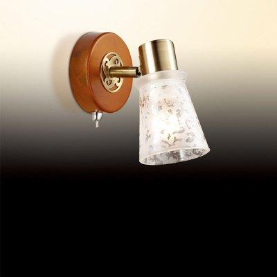 Светильник Odeon light 2614/1WОдиночные<br>Светильники-споты – это оригинальные изделия с современным дизайном. Они позволяют не ограничивать свою фантазию при выборе освещения для интерьера. Такие модели обеспечивают достаточно качественный свет. Благодаря компактным размерам Вы можете использовать несколько спотов для одного помещения.  Интернет-магазин «Светодом» предлагает необычный светильник-спот Odeon light 2614/1W  по привлекательной цене. Эта модель станет отличным дополнением к люстре, выполненной в том же стиле. Перед оформлением заказа изучите характеристики изделия.  Купить светильник-спот Odeon light 2614/1W  в нашем онлайн-магазине Вы можете либо с помощью формы на сайте, либо по указанным выше телефонам. Обратите внимание, что мы предлагаем доставку не только по Москве и Екатеринбургу, но и всем остальным российским городам.<br><br>S освещ. до, м2: 3<br>Тип цоколя: E14<br>Количество ламп: 1<br>MAX мощность ламп, Вт: 40<br>Диаметр, мм мм: 90<br>Высота, мм: 150<br>Цвет арматуры: бронзовый