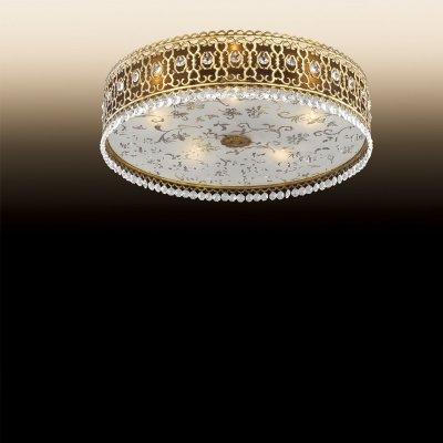 Люстра Odeon light 2641/5CПотолочные<br>Притягательный и роскошный восточный стиль в освещении создаст желанную атмосферу богатого убранства Вашего дома. Итальянские мастера потрудились на славу, создавая восхитительную люстру Odeon light 2641/5C, пропитанную приятным лоском и аккуратной манерностью. Достаточно взглянуть на художественную резку по металлу бронзового мерцания, из которого составлена узорчатая конструкция. Корпус изделия представляет собой гармоничное единение каждой детали. Основание люстры Odeon light 2641/5C дополнено художественной росписью в форме мягких узоров. Весь «шатёр» света, исходящего от пяти ламп, по периметру украшен переливающимися каменьями в форме гранул и капель.<br><br>Установка на натяжной потолок: Ограничено<br>S освещ. до, м2: 14<br>Крепление: Планка<br>Тип цоколя: E14<br>Количество ламп: 5<br>MAX мощность ламп, Вт: 40<br>Диаметр, мм мм: 415<br>Высота, мм: 110<br>Цвет арматуры: бронзовый