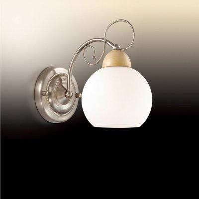 Светильник Odeon light 2658/1WМодерн<br>Настенное бра Odeon light 2658/1W источает лаконичное благородство в безупречном стиле модерн. Итальянское изделие имеет простую геометрию и понятные формы, но, при этом, дополнено отдельными оригинальными деталями. Белоснежный шарообразный плафон у основания накрыт купольным элементом из натурального дерева, что придаёт модное наполнение всей конструкции серебристого мерцания. Интересным штрихом  являются витиеватые изгибы отдельных деталей настенного бра Odeon light 2658/1W, которые придают изделию повышенную утончённость и мягкий модерновый стиль. Такой итальянский шедевр станет истинным украшением Вашего современного интерьера, достойного насыщенного сияния!<br><br>S освещ. до, м2: 4<br>Тип товара: Светильник настенный бра<br>Тип цоколя: E27<br>Количество ламп: 1<br>Ширина, мм: 130<br>MAX мощность ламп, Вт: 60<br>Высота, мм: 220<br>Оттенок (цвет): белый<br>Цвет арматуры: серый