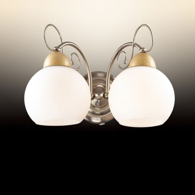 Светильник Odeon light 2658/2WМодерн<br>Настенное бра Odeon light 2658/2W пропитано лаконичным благородством в безупречном стиле модерн. Несмотря на то, что изделие имеет простую геометрию и понятные формы, оно дополнено и отдельными оригинальными деталями. Аккуратные шарообразные плафоны у основания накрыты купольными элементами из натурального дерева, что придаёт модное наполнение всей конструкции прекрасного серебристого мерцания. Интересным штрихом  являются витиеватые изгибы отдельных деталей настенного бра Odeon light 2658/2W, которые придают изделию повышенную утончённость и мягкий модерновый стиль. Такой итальянский шедевр станет истинным украшением Вашего современного интерьера, достойного насыщенного сияния!<br><br>S освещ. до, м2: 8<br>Тип товара: Светильник настенный бра<br>Скидка, %: 40<br>Тип цоколя: E27<br>Количество ламп: 2<br>Ширина, мм: 320<br>MAX мощность ламп, Вт: 60<br>Высота, мм: 220<br>Оттенок (цвет): белый<br>Цвет арматуры: серый