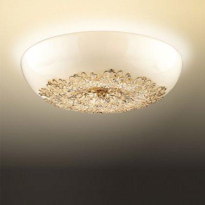 Люстра Odeon light 2677/8CПотолочные<br>Потолочный светильник Odeon light 2677/8C станет любимым предметом в Вашем доме! Конструкция выполнена таким образом, что все 8 ламп размещены в одном плафоне без дополнительных, «утяжеляющих» деталей и ненужных элементов декора, благодаря чему осветительный прибор выглядит легким, «воздушным» и зрительно увеличивает высоту комнаты. Гармоничное сочетание круглой формы с золотым и белым оттенком и «растительным» рисунком создает великолепный образ, наполненный благородной красотой и роскошью. Рекомендуем Вам использовать светильник совместно с настенно-потолочными источниками света из этой же серии, тогда интерьер будет выглядеть «законченным» и совершенным, как будто над ним поработал профессиональный дизайнер.<br><br>Установка на натяжной потолок: Ограничено<br>S освещ. до, м2: 22<br>Крепление: Планка<br>Тип цоколя: G9<br>Количество ламп: 8<br>MAX мощность ламп, Вт: 40<br>Диаметр, мм мм: 420<br>Высота, мм: 160<br>Оттенок (цвет): белый<br>Цвет арматуры: золотой