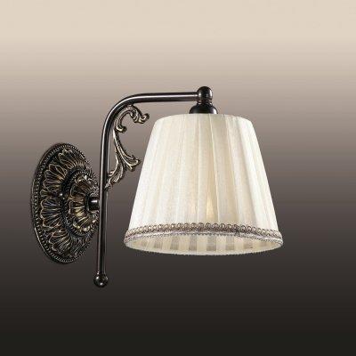 Настенный светильник odeon light 2696/1W VEADOСовременные<br><br><br>S освещ. до, м2: 4<br>Тип лампы: накаливания / энергосбережения / LED-светодиодная<br>Тип цоколя: E14<br>Количество ламп: 1<br>Ширина, мм: 150<br>MAX мощность ламп, Вт: 60<br>Расстояние от стены, мм: 220<br>Высота, мм: 240<br>Цвет арматуры: коричневый