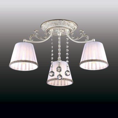 Люстра odeon light 2697/3C VEADOПотолочные<br>Вдохновенная рустика воплощена в потолочной люстре odeon light 2697/3C. Во-первых, перед Вами изделие высшего итальянского качества. Во-вторых, оно выполнено в лучших традициях европейской моды: стильной, изысканной и безупречной. При взоре на потолочную люстру odeon light 2697/3C возникает ощущение, что перед Вами истинное творение художников и скульпторов. В изделии прекрасно всё: начиная с цветового исполнения, заканчивая дизайном. Сочетание чистого белоснежного оттенка и золотистых вкраплений делает люстру odeon light 2697/3C стильной и благородной. Текстильные плафоны состоят из плотного и прозрачного материалов, гармонично дополняющих друг друга. Итальянский шедевр к тому же украшен хрустальными нитями. Так в едином творении воплощены итальянская грация, безупречный вкус и модные тенденции.<br><br>Установка на натяжной потолок: Да<br>S освещ. до, м2: 12<br>Крепление: Планка<br>Тип лампы: накаливания / энергосбережения / LED-светодиодная<br>Тип цоколя: E14<br>Количество ламп: 3<br>MAX мощность ламп, Вт: 60<br>Диаметр, мм мм: 540<br>Высота, мм: 260<br>Цвет арматуры: белый с золотистой патиной