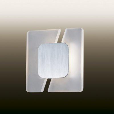 Настенный светильник odeon light 2720/5WL AMAFOХай-тек<br><br><br>S освещ. до, м2: 0<br>Тип товара: Светильник настенный бра<br>Тип лампы: LED - светодиодная<br>Тип цоколя: LED<br>Количество ламп: 1<br>Ширина, мм: 180<br>MAX мощность ламп, Вт: 5<br>Расстояние от стены, мм: 60<br>Высота, мм: 180<br>Цвет арматуры: серый