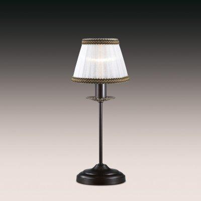 Настольная лампа odeon light 2771/1T MEISAКлассические<br>Настольная лампа – это не просто источник дополнительного освещения, но и оригинальный элемент декора. Его можно установить в спальне, гостиной, кабинете и других комнатах. Интернет-магазин «Светодом» предлагает настольные лампы разных стилей по доступным ценам. Благодаря большому ассортименту Вы обязательно найдете в нашем каталоге именно ту модель, которую искали.   Настольная лампа Odeon light 2771/1T  – прекрасный вариант для завершения интерьера. Ее можно включить одновременно с люстрой для более яркого освещения или без нее для создания уютной атмосферы, настраивающей на отдых.   Купить настольную лампу Odeon light 2771/1T  Вы можете с помощью виртуальной «Корзины» или по контактным номерам, указанным на сайте.<br><br>S освещ. до, м2: 2<br>Тип лампы: накал-я - энергосбер-я<br>Тип цоколя: E14<br>Количество ламп: 1<br>MAX мощность ламп, Вт: 40<br>Диаметр, мм мм: 180<br>Высота, мм: 400<br>Цвет арматуры: коричневый