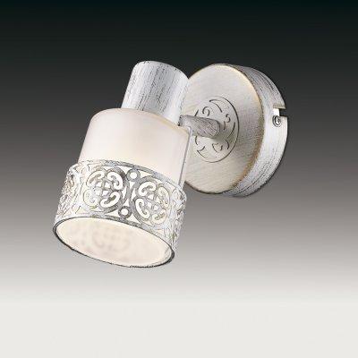 Светильник подсветка odeon light 2786/1W MATISOОдиночные<br>Светильники-споты – это оригинальные изделия с современным дизайном. Они позволяют не ограничивать свою фантазию при выборе освещения для интерьера. Такие модели обеспечивают достаточно качественный свет. Благодаря компактным размерам Вы можете использовать несколько спотов для одного помещения.  Интернет-магазин «Светодом» предлагает необычный светильник-спот Odeon light 2786/1W по привлекательной цене. Эта модель станет отличным дополнением к люстре, выполненной в том же стиле. Перед оформлением заказа изучите характеристики изделия.  Купить светильник-спот Odeon light 2786/1W в нашем онлайн-магазине Вы можете либо с помощью формы на сайте, либо по указанным выше телефонам. Обратите внимание, что у нас склады не только в Москве и Екатеринбурге, но и других городах России.<br><br>S освещ. до, м2: 2<br>Тип лампы: накал-я - энергосбер-я<br>Тип цоколя: E14<br>Количество ламп: 1<br>Ширина, мм: 90<br>MAX мощность ламп, Вт: 40<br>Расстояние от стены, мм: 130<br>Высота, мм: 110<br>Цвет арматуры: белый с золотистой патиной