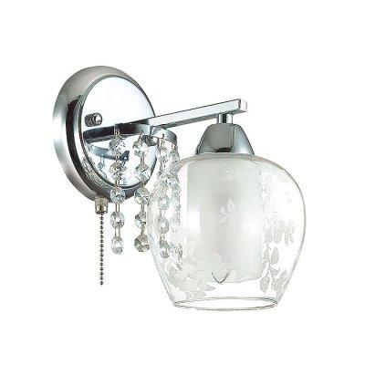 Настенный светильник бра Lumion 3065/1W KRISTALINСовременные<br>Бра 3065/1W серии Kristalin оформлена в современном стиле. Светильник состоит из плафона, изготовленного из двойного стекла, нижняя часть которого матовая, а верхняя - прозрачная с вензельным рисунком, и арматуры хромового цвета, обильно украшенной подвесками из хрусталя. С данной моделью свет в Вашей квартире заиграет новыми красками. Цоколь E14. Мощность 1x60W. Нет ламп в комплекте.<br><br>Крепление: Настенное<br>Тип лампы: накаливания / энергосбережения / LED-светодиодная<br>Тип цоколя: E14<br>Цвет арматуры: серебристый<br>Количество ламп: 1<br>Ширина, мм: 130<br>Диаметр, мм мм: 210<br>Длина, мм: 210<br>Высота, мм: 220<br>MAX мощность ламп, Вт: 60
