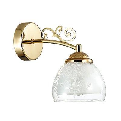 Настенный светильник бра Lumion 3072/1W MARLONAСовременные<br>Бра 3072/1W серии Marlona оформлена в современном стиле. Светильник состоит из плафона, изготовленного из двойного стекла, нижняя часть которого матовая, а верхняя - прозрачная с вензельным рисунком, и арматуры цвета золото, украшенной подвесками из хрусталя. Данная модель отлично подойдет как для классического интерьера за счет цвета, так и для современного за счет формы и плафонов. Цоколь E14. Мощность 1x40W. Нет ламп в комплекте.<br><br>Крепление: Настенное<br>Тип лампы: накаливания / энергосбережения / LED-светодиодная<br>Тип цоколя: E14<br>Цвет арматуры: Золотой<br>Количество ламп: 1<br>Ширина, мм: 230<br>Диаметр, мм мм: 230<br>Длина, мм: 130<br>Высота, мм: 260<br>MAX мощность ламп, Вт: 40