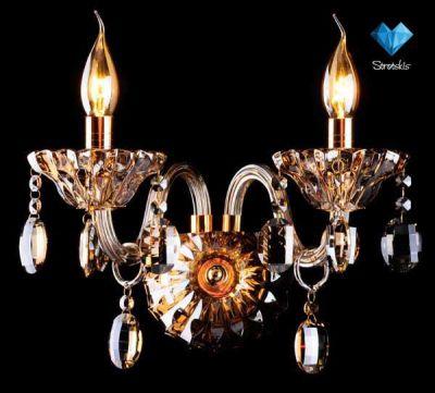 Светильник бра Евросвет 3162/2Хрустальные<br><br><br>S освещ. до, м2: 6<br>Тип лампы: накаливания / энергосбережения / LED-светодиодная<br>Тип цоколя: E14<br>Количество ламп: 2<br>Ширина, мм: 200<br>MAX мощность ламп, Вт: 60<br>Длина, мм: 350<br>Высота, мм: 260<br>Цвет арматуры: золотой