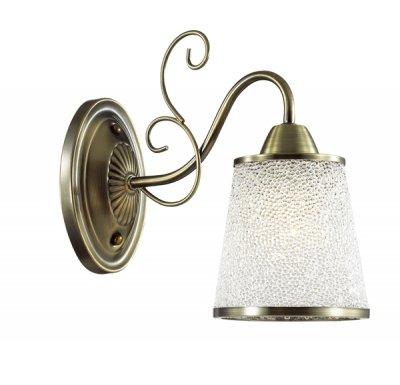 Настенный светильник бра Lumion 3226/1W BRUNIКлассические<br>Бра 3226/1W серии Bruni оформлена в классическом стиле. Светильник состоит из акрилового плафона с металлической окантовкой с эффектом мерцания и арматуры бронзового цвета. С данной моделью блистать станет еще легче. Цоколь E14. Мощность 1x40W. Нет ламп в комплекте.<br><br>Крепление: Настенное<br>Тип лампы: накаливания / энергосбережения / LED-светодиодная<br>Тип цоколя: E14<br>Количество ламп: 1<br>Ширина, мм: 130<br>MAX мощность ламп, Вт: 40<br>Диаметр, мм мм: 260<br>Длина, мм: 260<br>Высота, мм: 240<br>Цвет арматуры: бронзовый