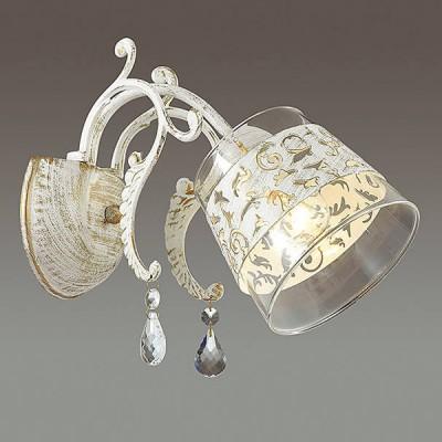 Светильник Lumion 3305/1WКлассические<br>Элегантная серия Delfina в белом исполнении с золотой патиной и ажурным декором на стеклянном плафоне. Функциональная и изящная серия станет изюминкой вашего интерьера.<br><br>Крепление: Настенное<br>Тип лампы: Накаливания / энергосбережения / светодиодная<br>Тип цоколя: E14<br>Количество ламп: 1<br>Ширина, мм: 230<br>Расстояние от стены, мм: 290<br>Высота, мм: 250<br>MAX мощность ламп, Вт: 40