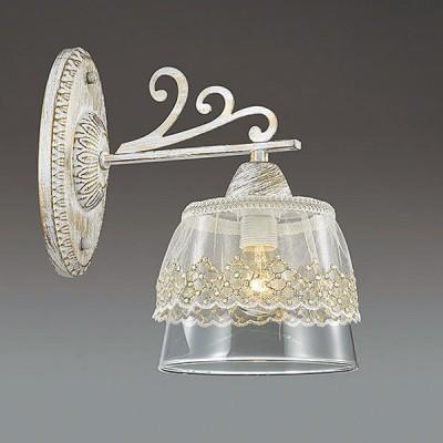 Светильник Lumion 3310/1WКлассические<br>Серия Kapukaina - это воплощение шарма и грации классического стиля. Основание с утонченными декорами выполнено в белом цвете с золотой патиной. Стеклянные плафоны декорированы легкой прозрачной тканью кремового цвета, украшенной стразами.<br><br>Крепление: Настенное<br>Тип лампы: Накаливания / энергосбережения / светодиодная<br>Тип цоколя: E14<br>Количество ламп: 1<br>Ширина, мм: 140<br>Расстояние от стены, мм: 225<br>Высота, мм: 250<br>MAX мощность ламп, Вт: 40