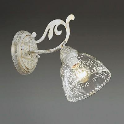 Светильник Lumion 3311/1WКлассические<br>Центром притяжения в серии Nicuola являются стеклянные плафоны с ажурным орнаментом, выполненным в белом цвете. Они идеально сочетаются с основанием в белом цвете с золотой патиной и хрустальными подвесками.<br><br>Крепление: Настенное<br>Тип лампы: Накаливания / энергосбережения / светодиодная<br>Тип цоколя: E14<br>Количество ламп: 1<br>Ширина, мм: 120<br>Расстояние от стены, мм: 250<br>Высота, мм: 220<br>MAX мощность ламп, Вт: 40