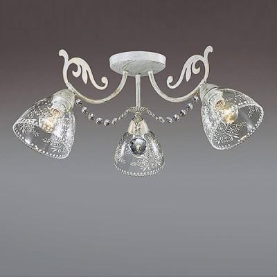 Светильник Lumion 3311/3CПотолочные<br>Центром притяжения в серии Nicuola являются стеклянные плафоны с ажурным орнаментом, выполненным в белом цвете. Они идеально сочетаются с основанием в белом цвете с золотой патиной и хрустальными подвесками.<br><br>Установка на натяжной потолок: Да<br>S освещ. до, м2: 6<br>Крепление: Потолочное<br>Тип лампы: Накаливания / энергосбережения / светодиодная<br>Тип цоколя: E14<br>Количество ламп: 3<br>Диаметр, мм мм: 610<br>Высота, мм: 235<br>MAX мощность ламп, Вт: 40