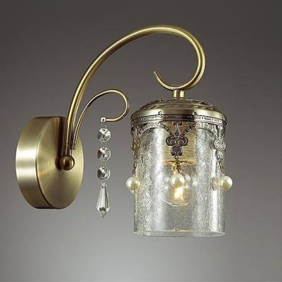 Светильник Lumion 3388/1WКлассические<br>Элегантная, легкая серия Tibo в цвете бронза  будет смотреться изящно и стильно в любом интерьере. Металлические декоры в готическом стиле в сочетании с толстым стеклом создают атмосферу легкости и торжественности.<br><br>Крепление: Настенное<br>Тип лампы: Накаливания / энергосбережения / светодиодная<br>Тип цоколя: E14<br>Количество ламп: 1<br>Ширина, мм: 110<br>Расстояние от стены, мм: 210<br>Высота, мм: 225<br>MAX мощность ламп, Вт: 60