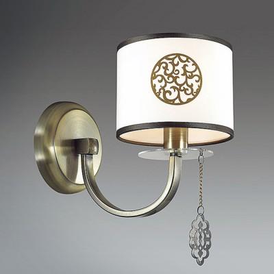 Светильник Lumion 3399/1WКлассические<br>Enna - элегантный и  претенциозный дизайн с использованием оригинальных декоров и подвесок. На абажур нанесен изящный орнамент, который достаточно универсален по совместимости с различными интерьерами. Тканевые кисточки привнесут домашний уют в любой интерьер.<br><br>Крепление: Настенное<br>Тип лампы: Накаливания / энергосбережения / светодиодная<br>Тип цоколя: E14<br>Количество ламп: 1<br>Ширина, мм: 140<br>Расстояние от стены, мм: 240<br>Высота, мм: 250<br>MAX мощность ламп, Вт: 40