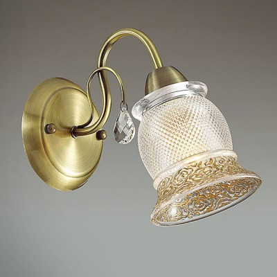 Светильник Lumion 3415/1WКлассические<br>В серии Rakella используются эффектные стеклянные плафоны с рифлением и орнаментом, декорированным золотой покраской. Благодаря плафонам свет будет мягким и комфортным с приятным золотистым эффектом.<br><br>Крепление: Настенное<br>Тип лампы: Накаливания / энергосбережения / светодиодная<br>Тип цоколя: E14<br>Количество ламп: 1<br>Ширина, мм: 120<br>Расстояние от стены, мм: 240<br>Высота, мм: 195<br>MAX мощность ламп, Вт: 40