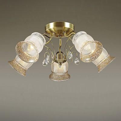 Светильник Lumion 3415/5CПотолочные<br>В серии Rakella используются эффектные стеклянные плафоны с рифлением и орнаментом, декорированным золотой покраской. Благодаря плафонам свет будет мягким и комфортным с приятным золотистым эффектом.<br><br>Установка на натяжной потолок: Да<br>S освещ. до, м2: 15<br>Крепление: Потолочное<br>Тип лампы: Накаливания / энергосбережения / светодиодная<br>Тип цоколя: E14<br>Количество ламп: 5<br>Диаметр, мм мм: 580<br>Высота, мм: 230<br>MAX мощность ламп, Вт: 60