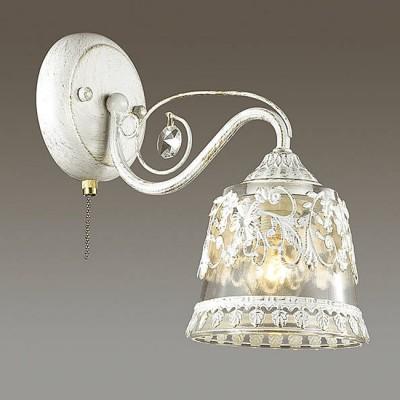 Светильник Lumion 3433/1WКлассические<br>Серия Olimpia в белом исполнениеи с золотой патиной со множеством ажурных элементов создает парящее ощущение легкости и воздушности. Стеклянный плафон из белого матового стекла будет дарить мягкое и комфортное освещение.<br><br>Крепление: Настенное<br>Тип лампы: Накаливания / энергосбережения / светодиодная<br>Тип цоколя: E14<br>Количество ламп: 1<br>Ширина, мм: 125<br>Расстояние от стены, мм: 250<br>Высота, мм: 240<br>MAX мощность ламп, Вт: 60