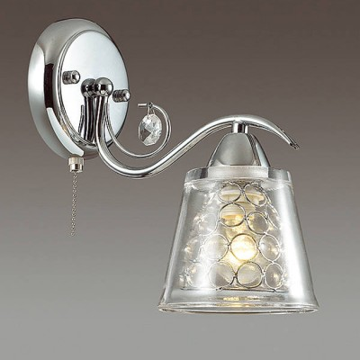 Светильник Lumion 3445/1WСовременные<br>Cерия Polina в хроме смотрится чрезвычайно эффектно и актуально благодаря оригинальному двойному плафону: прозрачному стеклянному и металлическому ажурному внутри.<br><br>Крепление: Настенное<br>Тип лампы: Накаливания / энергосбережения / светодиодная<br>Тип цоколя: E14<br>Количество ламп: 1<br>Ширина, мм: 125<br>MAX мощность ламп, Вт: 60<br>Расстояние от стены, мм: 230<br>Высота, мм: 240