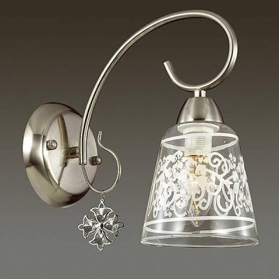 Светильник Lumion 3469/1WКлассические<br>Серия Barnibbo - это элегантные светильники в цвете матовый никель для функционального освещения в классическом интерьере. В ней используются массивные стеклянные плафоны с утонченным рисунком, благодаря которым в помещении будет обеспечено мягкое освещение.  Изящные подвески придают светильнику нарядность.<br><br>Крепление: Настенное<br>Тип лампы: Накаливания / энергосбережения / светодиодная<br>Тип цоколя: E14<br>Количество ламп: 1<br>Ширина, мм: 120<br>MAX мощность ламп, Вт: 40<br>Расстояние от стены, мм: 260<br>Высота, мм: 255