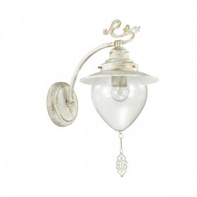 Светильник Lumion 3495/1WОжидается<br>Серия Prana в белом цвете с золотой патиной в сочетании с прозрачными плафонами смотрится изящно и невесомо. Декоративные ажурные подвески, украшающие плафон, гармонично сочетаются с декоративными металлическими элементами на рожках<br><br>Тип цоколя: E27<br>Количество ламп: 1<br>Ширина, мм: 200<br>MAX мощность ламп, Вт: 60<br>Длина, мм: 290<br>Расстояние от стены, мм: 25<br>Оттенок (цвет): белый / зол.патина