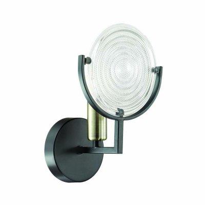Светильник Lumion 3510/1WЛофт<br>Уникальная серия Lunapiena сочетает невероятно стильную арматуру состаренного черного цвета со смелым дизайном и необычные стеклянные плафоны в виде рельефных дисков. Такой светильник способен погрузить в атмосферу прошлого века, наполненной стилем, лоском и экстравагантностью<br><br>Тип цоколя: E14<br>Количество ламп: 1<br>Ширина, мм: 138<br>Длина, мм: 140<br>Расстояние от стены, мм: 25<br>Оттенок (цвет): металл черный с эффектом состаривания<br>MAX мощность ламп, Вт: 60