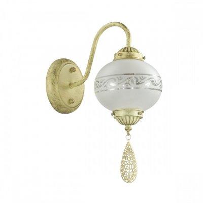 Светильник Lumion 3531/1WОжидается<br>Изысканная и слегка экзотичная серия Tamika выполнена в цвете бронза и украшена красивыми круглыми матовыми плафонами. Шарма и экзотичности светильнику придают изящные узоры на стекле, а также декоративные ажурные подвески<br><br>Тип цоколя: E14<br>Количество ламп: 1<br>MAX мощность ламп, Вт: 40<br>Оттенок (цвет): слоновая кость с золот.патиной