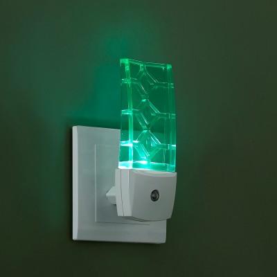 Novotech NIGHT LIGHT 357330 Светильник ночникНочники<br>Светильник-ночник (в розетку) светодиодный с датчиком света модели Novotech 357330 из серии NIGHT LIGHT отличается следующим качеством: Корпус светильника сделан из пластика ПК. Преимуществами данного материала являются: 1. Химическая инертность – материал устойчив к воздействию кислот и щелочей, продуктов нефтепереработки; 2. Устойчивость к воздействию влаги; 3. Ударопрочность; 4. Долговечность; 5. Ровная поверхность Датчик света (датчик освещённости) – свет включается при наступлении темноты и недостаточном освещении.<br><br>Тип лампы: LED<br>Тип цоколя: LED<br>Ширина, мм: 50<br>MAX мощность ламп, Вт: 0,5<br>Расстояние от стены, мм: 44<br>Высота, мм: 120<br>Цвет арматуры: белый