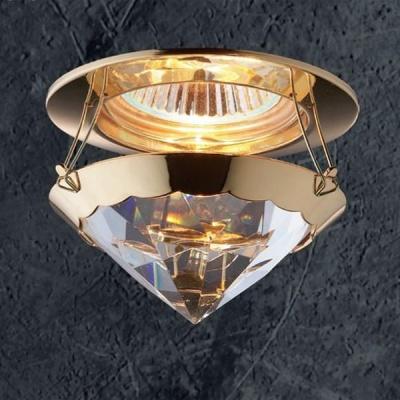Novotech GLAM 369336 Встраиваемый светильникКруглые<br>Светильники для низковольтных галогенных ламп. Материал: алюминиевое литье. Хрусталь.<br><br>S освещ. до, м2: 3<br>Тип лампы: галогенная<br>Тип цоколя: GU5.3 (MR16)<br>Количество ламп: 1<br>MAX мощность ламп, Вт: 50<br>Диаметр, мм мм: 100<br>Диаметр врезного отверстия, мм: 60<br>Высота, мм: 130<br>Оттенок (цвет): прозрачный<br>Цвет арматуры: Золотой