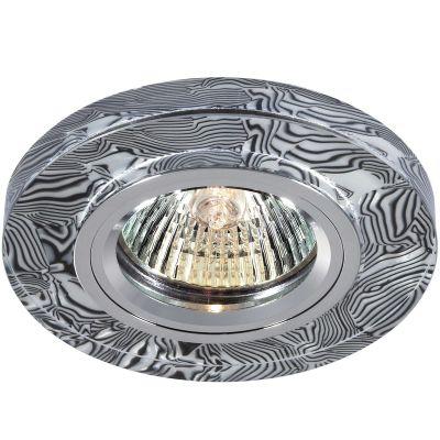 Novotech FANCY 369590 Встраиваемый светильникКруглые<br>Декоративный встраиваемый светильник модели Novotech 369590 из серии FANCY отличается следующим качеством: Основание светильника сделано из алюминия. Это лёгкий металл, основными  достоинствами которого являются — устойчивость к практически всем видам негативного воздействия окружающей среды, коррозии, небольшой вес, по сравнению с другими видами металла и   экологическая безопасность материала. Декоративный плафон произведен из хрусталя. Он обладает высоким показателем плотности, прозрачности и блеска. Благодаря содержанию свинца (не менее 30%) и определённому подбору углов, образуемых гранями, изделия из хрусталя отличаются необыкновенно яркой, многоцветной игрой света, чарующей магией красоты, совершенства и роскоши.<br><br>S освещ. до, м2: 2<br>Тип лампы: галогенная<br>Тип цоколя: GU5.3 (MR16)<br>MAX мощность ламп, Вт: 50<br>Диаметр, мм мм: 90<br>Диаметр врезного отверстия, мм: 68<br>Расстояние от стены, мм: 10<br>Высота, мм: 20<br>Цвет арматуры: серебристый