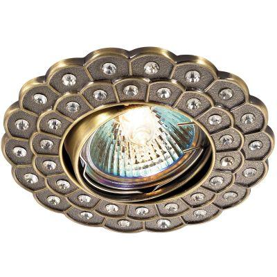 Novotech FLOWER 369824 Точечный встраиваемый светильникТочечные светильники круглые<br>Стандартный встраиваемый поворотный светильник модели Novotech 369824 из серии FLOWER отличается следующим качеством: Светильник сделан из алюминиевого литья. Это сплав, основными  достоинствами которого являются — устойчивость к практически всем видам негативного воздействия окружающей среды, коррозии, небольшой вес, по сравнению с другими видами металла и   экологическая безопасность материала.   Декоративные стразы произведены из хрусталя. Он обладает высоким показателем плотности, прозрачности и блеска. Благодаря содержанию свинца (не менее 30%) и определённому подбору углов, образуемых гранями, изделия из хрусталя отличаются необыкновенно яркой, многоцветной игрой света, чарующей магией красоты, совершенства и роскоши.<br><br>S освещ. до, м2: 2<br>Тип лампы: галогенная<br>Тип цоколя: GU5.3 (MR16)<br>Цвет арматуры: бронзовый<br>Диаметр, мм мм: 100<br>Диаметр врезного отверстия, мм: 78<br>Расстояние от стены, мм: 5<br>Высота, мм: 25<br>MAX мощность ламп, Вт: 50