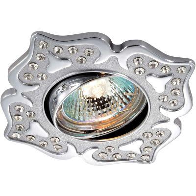 Novotech FLOWER 369826 Точечный встраиваемый светильникДекоративные<br>Стандартный встраиваемый поворотный светильник модели Novotech 369826 из серии FLOWER отличается следующим качеством: Светильник сделан из алюминиевого литья. Это сплав, основными  достоинствами которого являются — устойчивость к практически всем видам негативного воздействия окружающей среды, коррозии, небольшой вес, по сравнению с другими видами металла и   экологическая безопасность материала.   Декоративные стразы произведены из хрусталя. Он обладает высоким показателем плотности, прозрачности и блеска. Благодаря содержанию свинца (не менее 30%) и определённому подбору углов, образуемых гранями, изделия из хрусталя отличаются необыкновенно яркой, многоцветной игрой света, чарующей магией красоты, совершенства и роскоши.<br><br>S освещ. до, м2: 2<br>Тип товара: Точечный встраиваемый светильник<br>Тип лампы: галогенная<br>Тип цоколя: GU5.3 (MR16)<br>Ширина, мм: 103<br>MAX мощность ламп, Вт: 50<br>Диаметр врезного отверстия, мм: 78<br>Длина, мм: 103<br>Расстояние от стены, мм: 5<br>Высота, мм: 25<br>Оттенок (цвет): серебристый<br>Цвет арматуры: серебристый