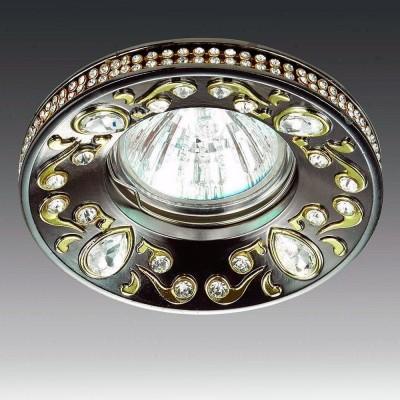Novotech ERBA 370236 Светильник встраиваемыйКруглые<br>Встраиваемый декоративный светильник модели Novotech 370236 из серии ERBA отличается следующим качеством: Светильник произведен из сплава цинка.  Благодаря сравнительно высоким механическим и литейным качествам, изделия, выполненные из сплава цинка, отличаются высокой точностью деталей декора со сложной конфигурацией. Так же он обладает антикоррозийными свойствами. Декоративные украшения сделаны из хрусталя. Огранка хрусталя, подобно огранке драгоценных камней, позволяет в полной мере проявить свойства, обусловленные большим показателем преломления и дисперсией.<br><br>Тип товара: Светильник встраиваемый<br>Тип лампы: галогенная/LED<br>Тип цоколя: GX5.3<br>MAX мощность ламп, Вт: 50<br>Диаметр, мм мм: 96<br>Диаметр врезного отверстия, мм: 75<br>Высота, мм: 27<br>Цвет арматуры: бронзовый