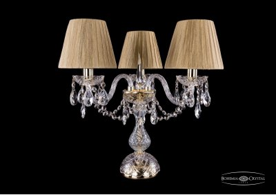Настольная лампа Bohemia Ivele 5706/3/141-39/G/SH7Хрустальные<br><br><br>Тип товара: Настольная лампа<br>Тип лампы: накаливания / энергосбережения / LED-светодиодная<br>Тип цоколя: Е14<br>Количество ламп: 3<br>Диаметр, мм мм: 440<br>Высота, мм: 390<br>Цвет арматуры: Золотой