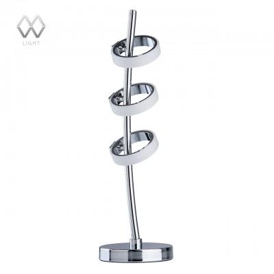 Настольная лампа Mw light 632034103 ГэлэксиХай тек<br>Описание модели 632034103: Светильник из коллекции «Гэлэкси» - это высокая технологичность и необыкновенный оригинальный дизайн. Его металлические снование и ножка гальванизированы в цвет хрома и удачно дополнены грациозными плафонами-кольцами того же оттенка. Они элегантно расположены в верхней части светильника и легко поворачиваются вверх-вниз, что позволяет создавать оригинальные световые акценты. Светящиеся в темноте кольца вызывают настоящее восхищение.<br><br>S освещ. до, м2: 5<br>Тип лампы: LED<br>Тип цоколя: LED<br>Количество ламп: 3<br>MAX мощность ламп, Вт: 5<br>Диаметр, мм мм: 140<br>Высота, мм: 510<br>Цвет арматуры: серебристый