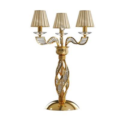 Lightstar ALVEARE 702932 Настольная лампаСовременные<br>Настольная лампа Alveare создана по подобию старинных подсвечников. Металлическое основание покрыто глянцевой позолотой и украшено волнами хрустальных бус. Плафоны выполнены из стекла с эффектом топленного сахара. В свете на стекле образуется эффект блестящей поверхности. Три лампы дают яркий и насыщенный теплый свет, который прекрасно украсит гостиную или спальню.<br> Настольная лампа Lightstar 702932 – прекрасный вариант для завершения интерьера. Ее можно включить одновременно с люстрой для более яркого освещения или без нее для создания уютной атмосферы, настраивающей на отдых. <br> Купить настольную лампу Lightstar 702932 Вы можете с помощью виртуальной «Корзины» или по контактным номерам, указанным на сайте.<br><br>Тип цоколя: E14<br>Цвет арматуры: золотой<br>Количество ламп: 3<br>Размеры: D 500 H 700<br>MAX мощность ламп, Вт: 40