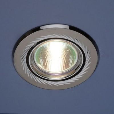 Точечный светильник Электростандарт 704A CX GU/CH (черный/серебро)круглые точечные светильники<br>Лампа: MR16 G5.3 max 50 Вт Диаметр: ? 86 мм Высота внутренней части: ? 20 мм Высота внешней части: ? 4 мм Монтажное отверстие: ? 76 мм Гарантия: 2 года Светильник имеет поворотный механизм